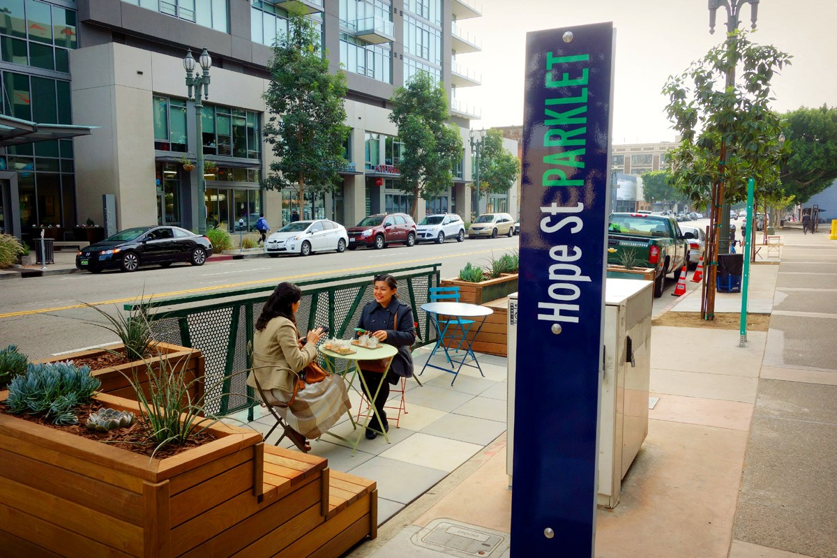 Parklets are great additions to the urban fabric of a neighborhood, but they can't take the place of real, full-sized parks. Photo from  DTLA Rising by Brigham Yen .