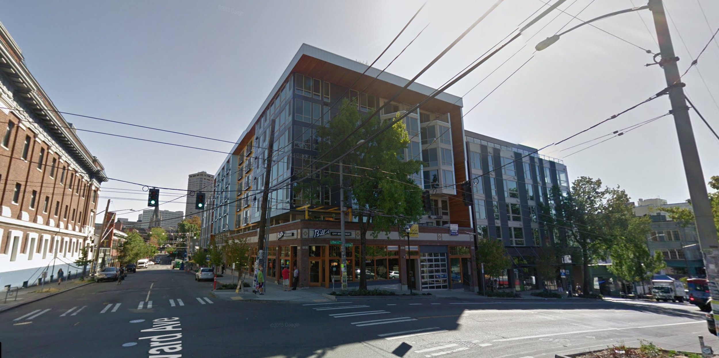 A new building in Seattle's Capitol Hill neighborhood, where the facade was maintained and 5 stories of housing were built above it. The pre-redevelopment business, a bar named Bill's Off Broadway, returned to its location on the ground floor when development was complete.
