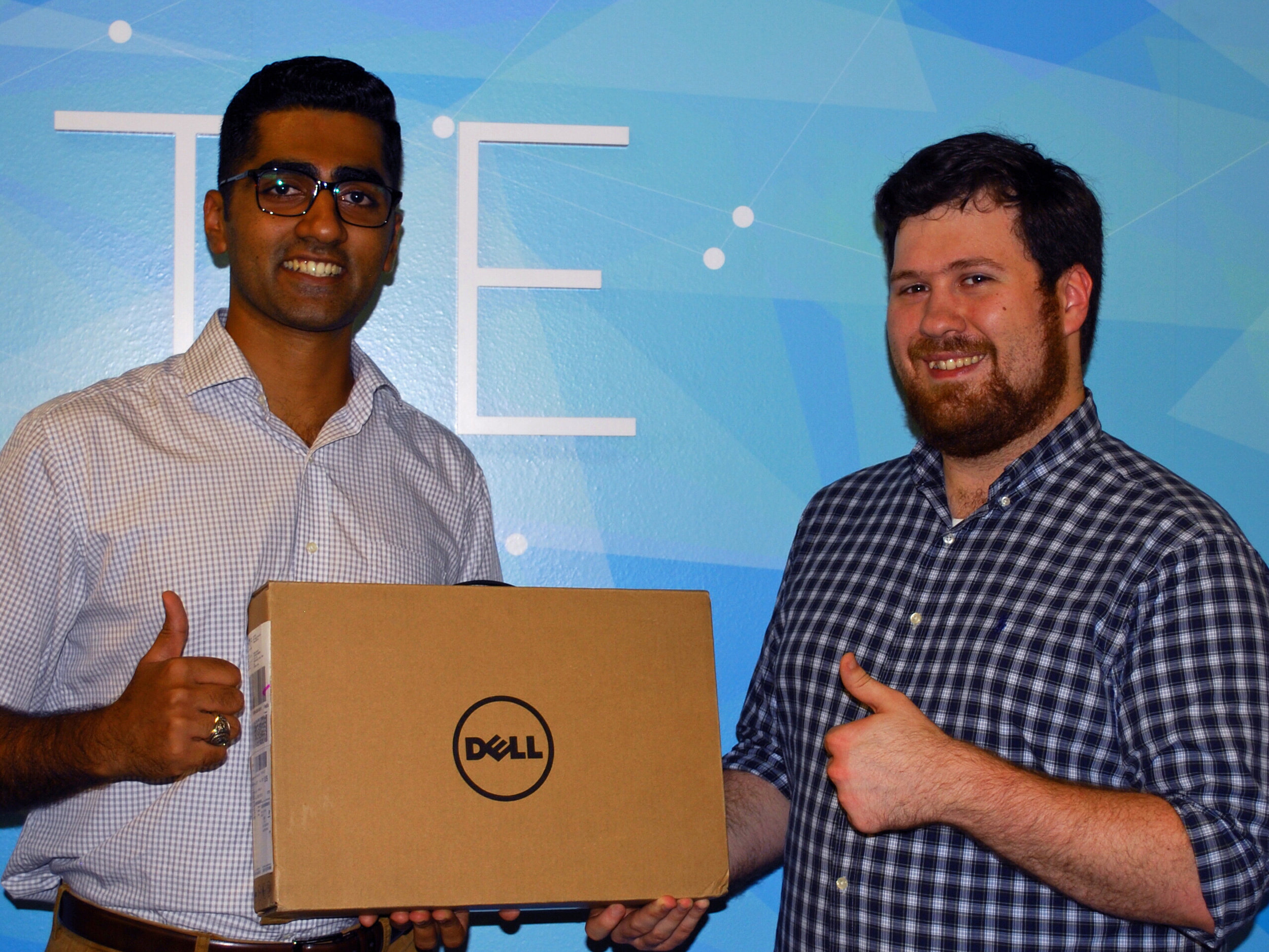 Last year's winner Zaid Nasir presenting this year's winner, Jeremy Klutts, with his prize.