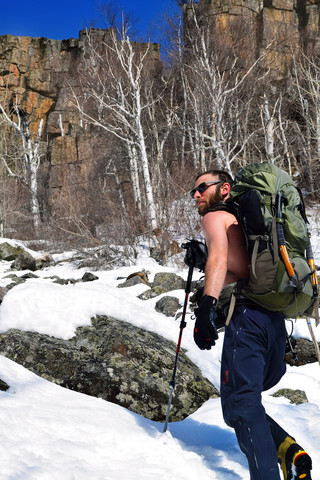 Amir Fishman hiking up to an ice climb in Thunder Bay