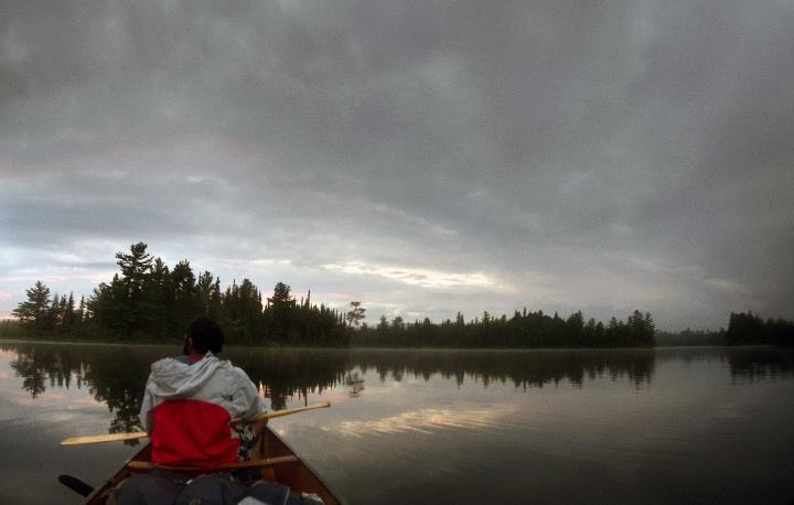 Cyril Francis enjoying a paddle as the sun starts to make its way down