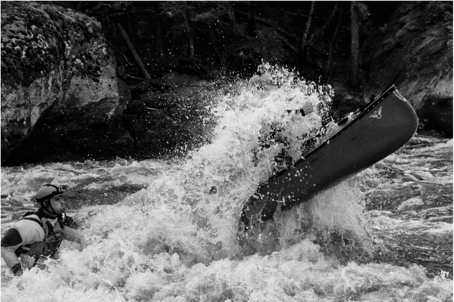 Mitch Taylor powering through some large white water on the Bloodvein River