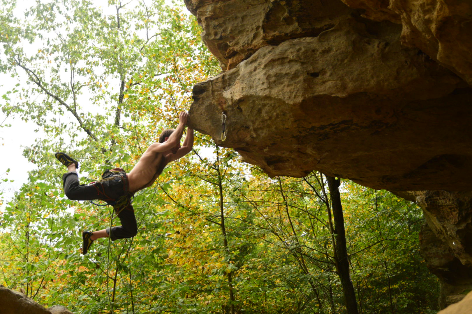 Amir Fishman making a hard move in the Red River Gorge, Kentucky