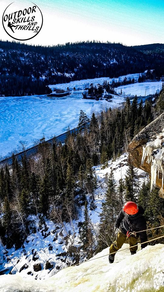 """It's easier to overcome one's fear of heights with a view like this.""  Near the top of a frozen waterfall, Thunder Bay, Ontario."