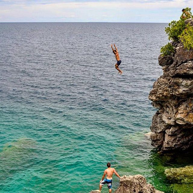 A warm picture for you on this VERY cold day!  This may look like a cliff jump, but it's actually just a really large person standing in the distance and cheering. I know. It really looks like a cliff jump. . . . . . #adventure #overhangadventures #fun #awesome #nature #goplayoutside #overhang #smile #ontario #yourstodiscover #camping #outside #outdoors #wilderness #natureporn #campingfun #brucepeninsula