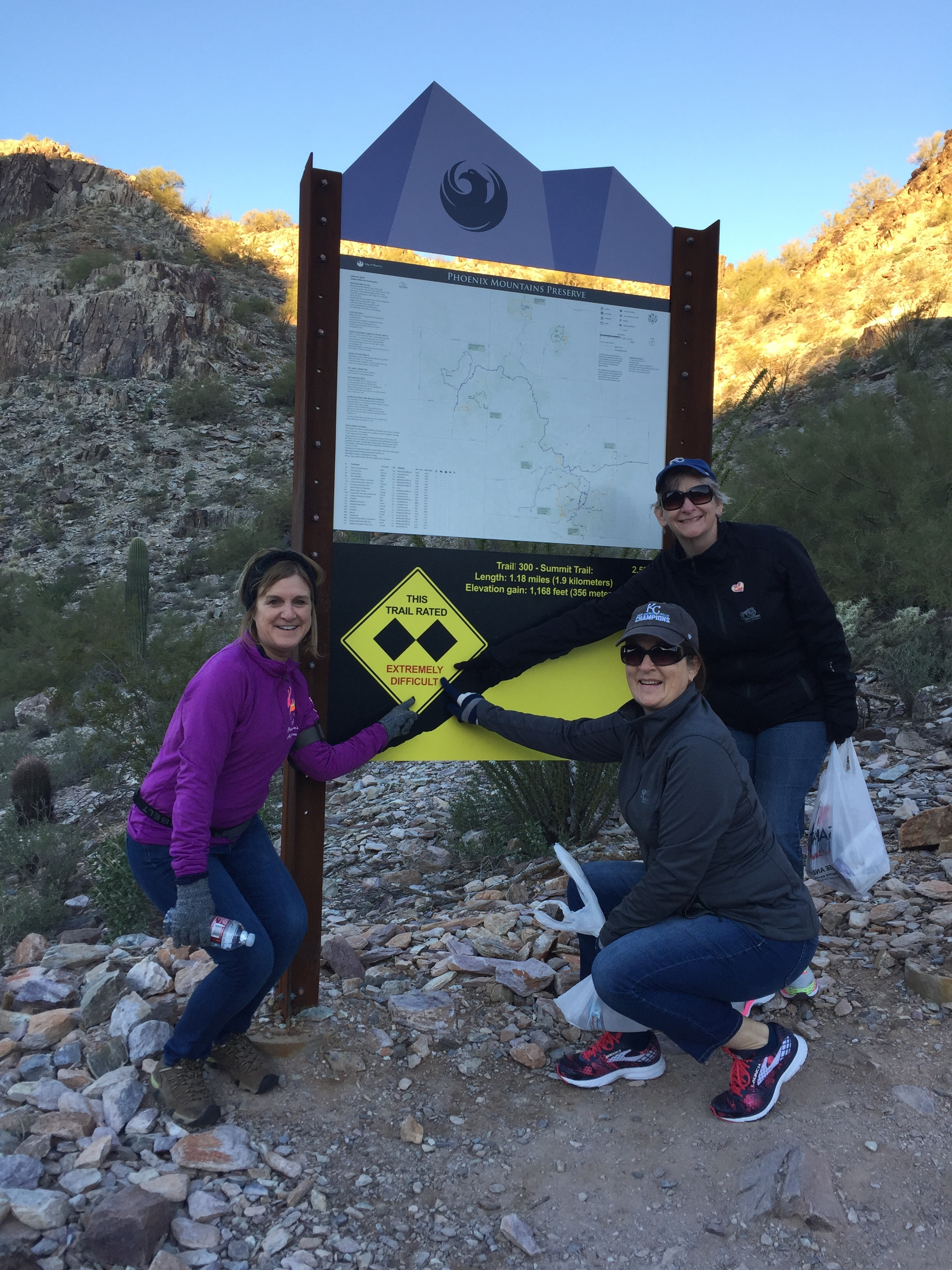 """Cheryl, Deidre and Harriett pointing out that the trail is marked """"Extremely Difficult."""""""