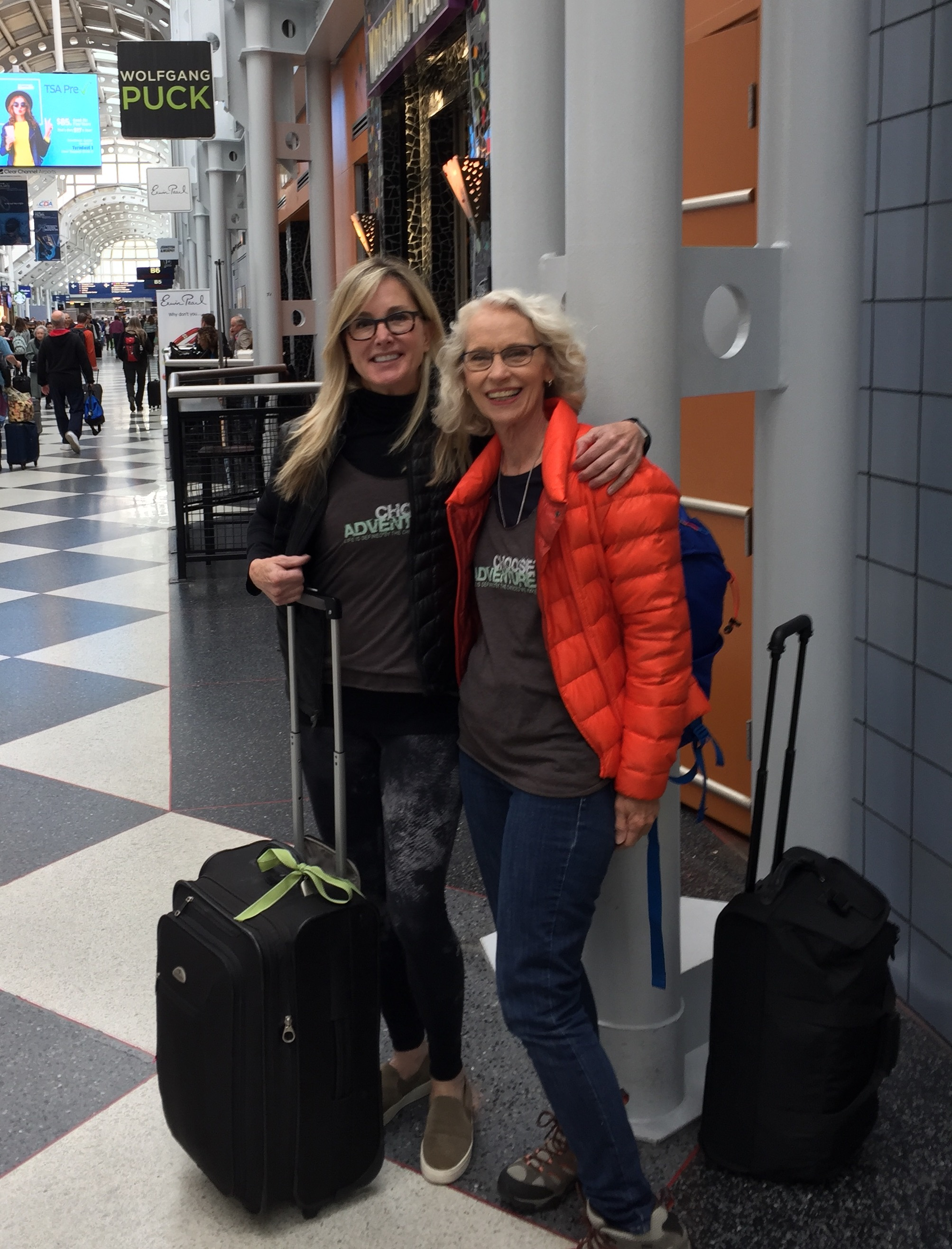 """Julie and I at O'Hare leaving for Lima. Might be the last time I was clean for a week! Julie got us these awesome """"Choose Adventure"""" shirts which was one of our hashtags for the trip. Love them!!!"""