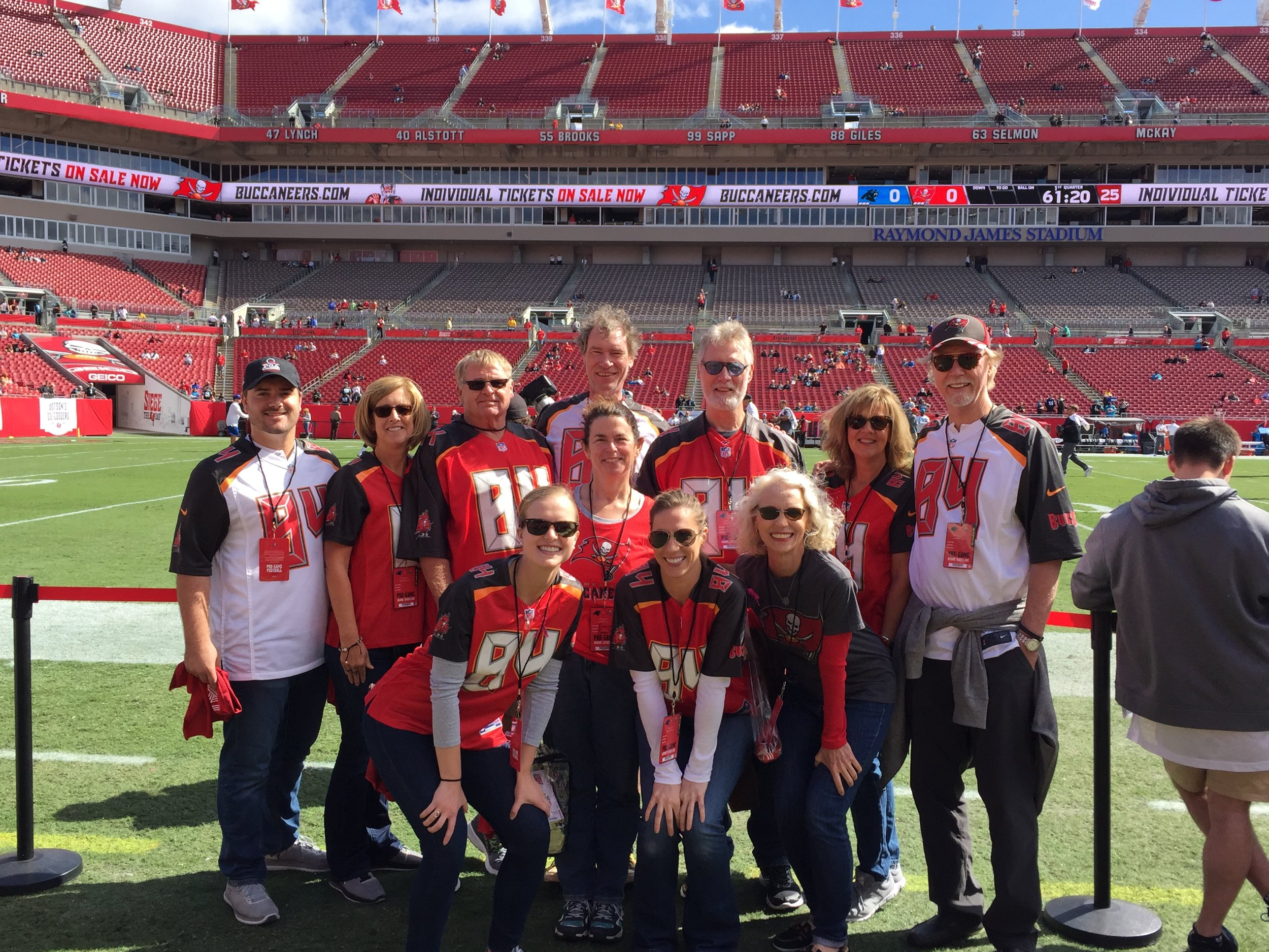 Back row left to right - cousins Jack, Susan and John Brate. Brothers Tom and Dave, sister-in-law Pat and brother Phil. Middle - sister-in-law Tracy. Front row - Keeley, niece Angela and me. Lots of #84 Brate jerseys!