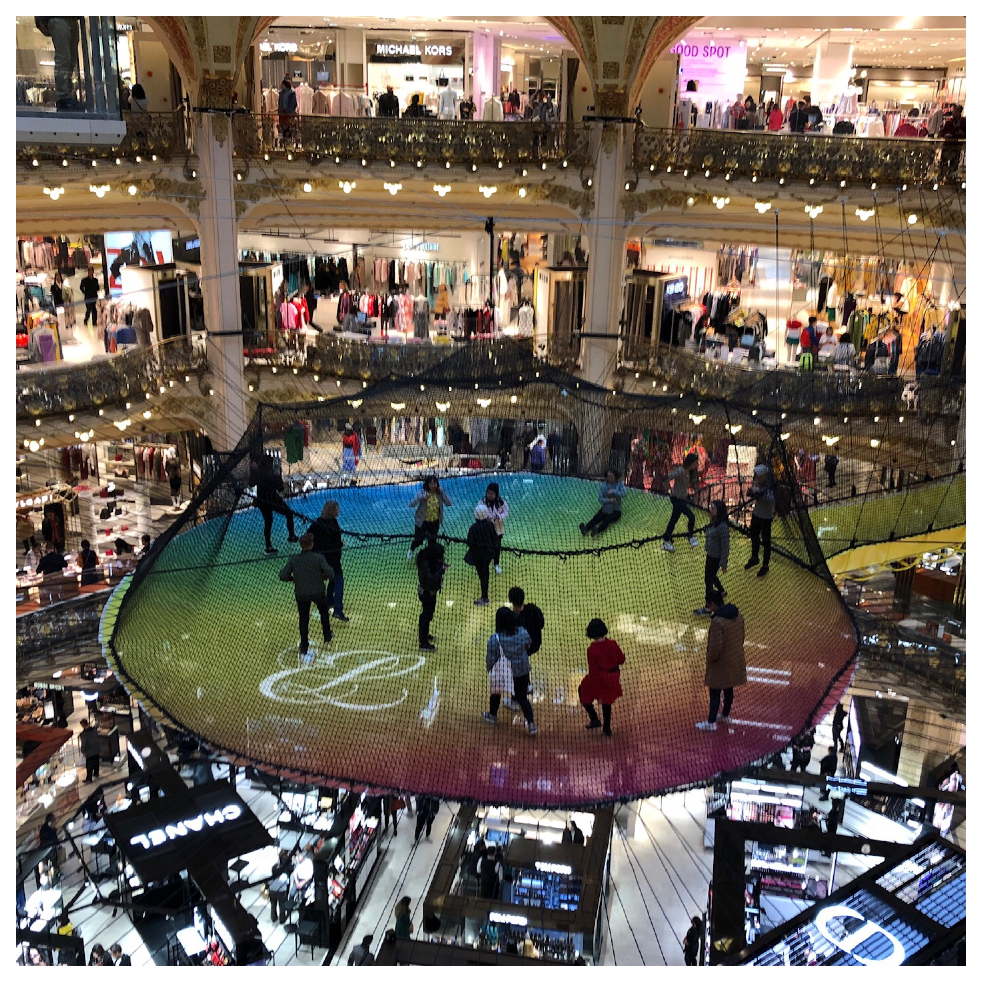 My favorite is Galleries Lafayette. It has an incredible Tiffany ceiling, great restaurants and fun fashions. When I was there over Christmas they had a big Christmas tree that has now been replaced by a huge trampoline that people enter from the 4th level. No thanks!