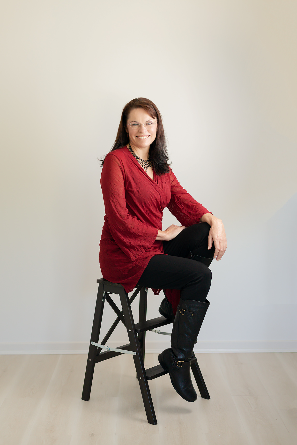Image of Cathy sitting on a chair