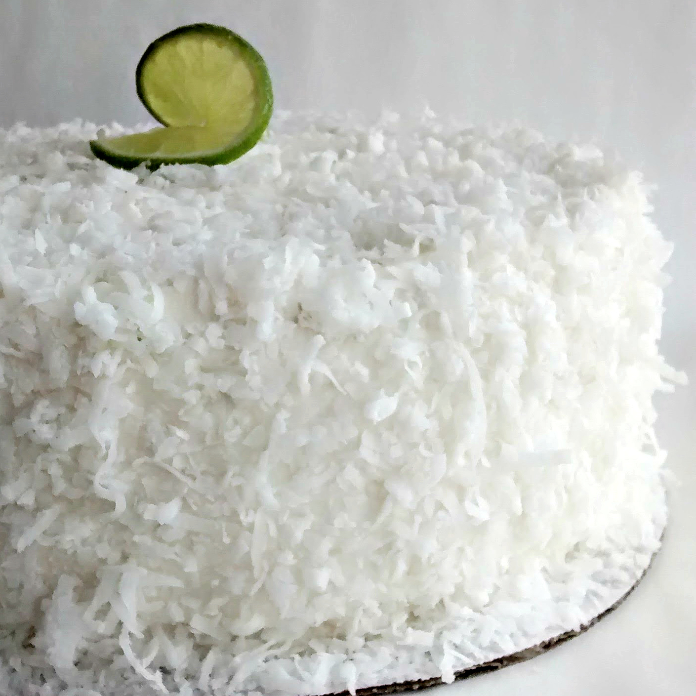Coconut Lime   Coconut layers, lime curd filling, coconut buttercream, and covered in fluffy coconut.