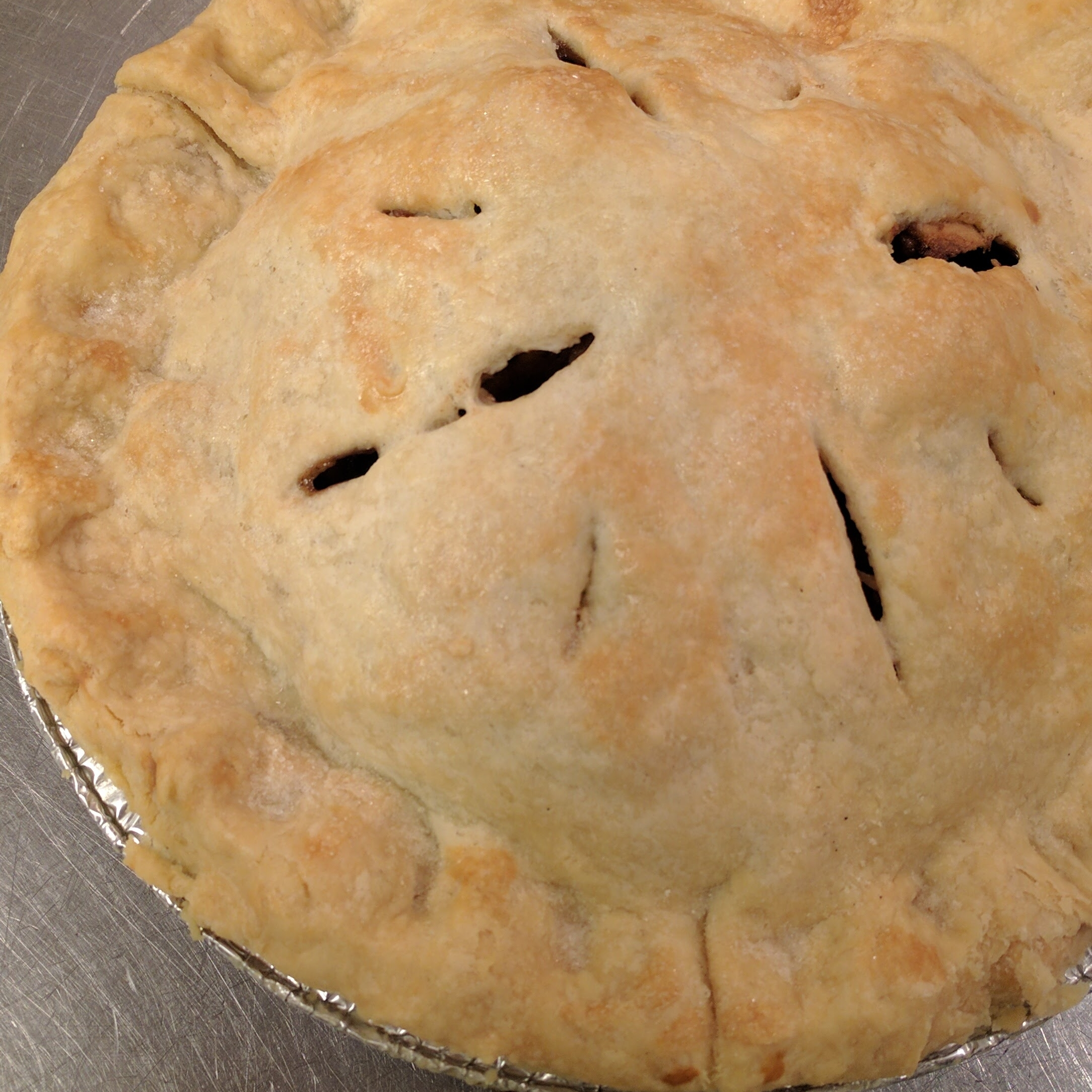 Apple   Generously heaped with spiced apples;topped with a flaky, hand-rolled crust and a sprinkling of sugar. $18
