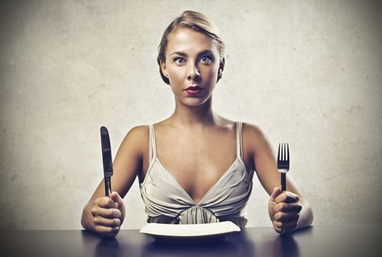 hungry-woman-with-empty-plate.jpg