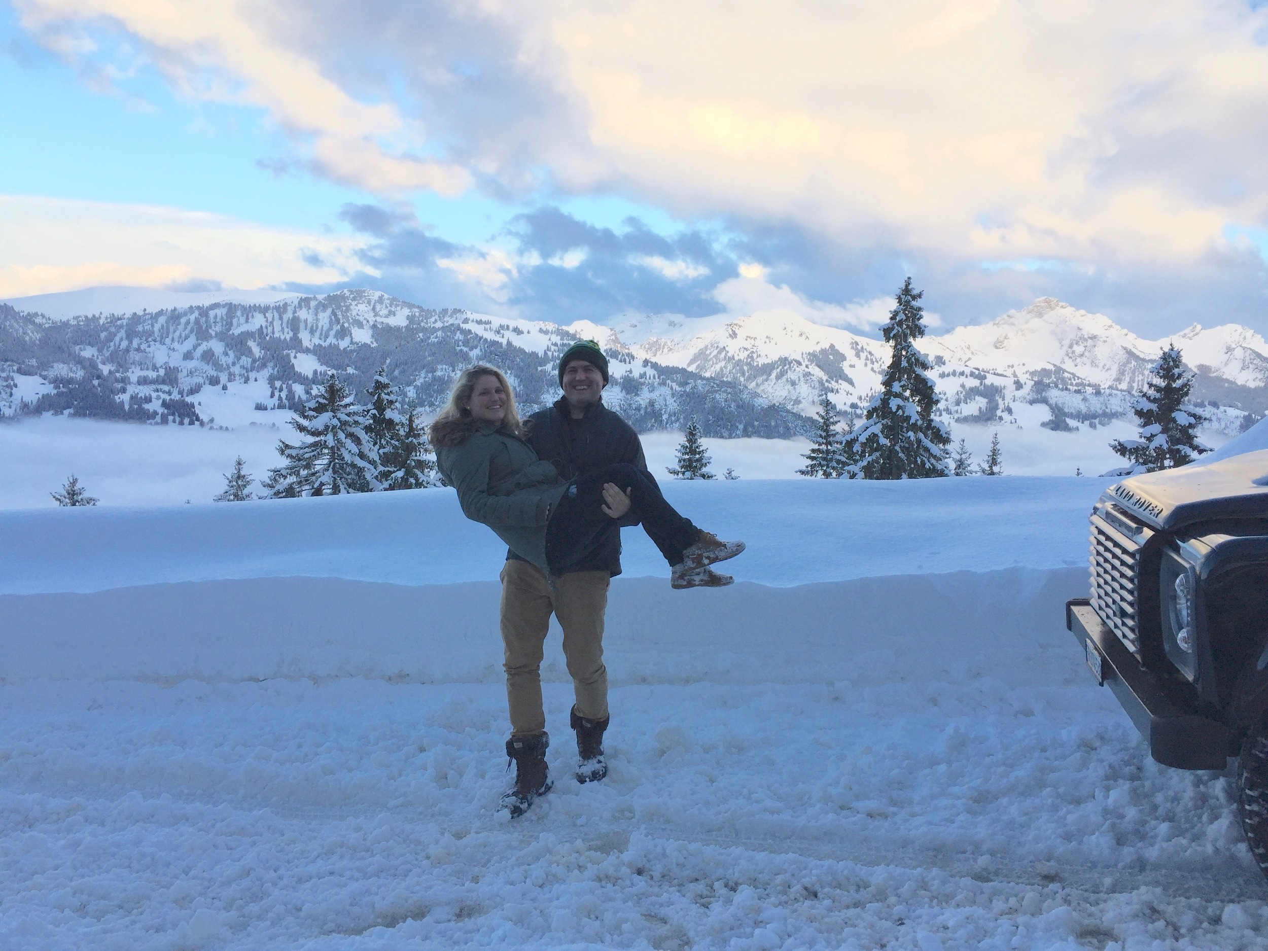 """- March 2016: Erin and Dan, just before Erin landed in the snow. At the Jaun Pass, Berner Oberland mountains behind, on the """"Dazzling Gruyère"""" Tour"""