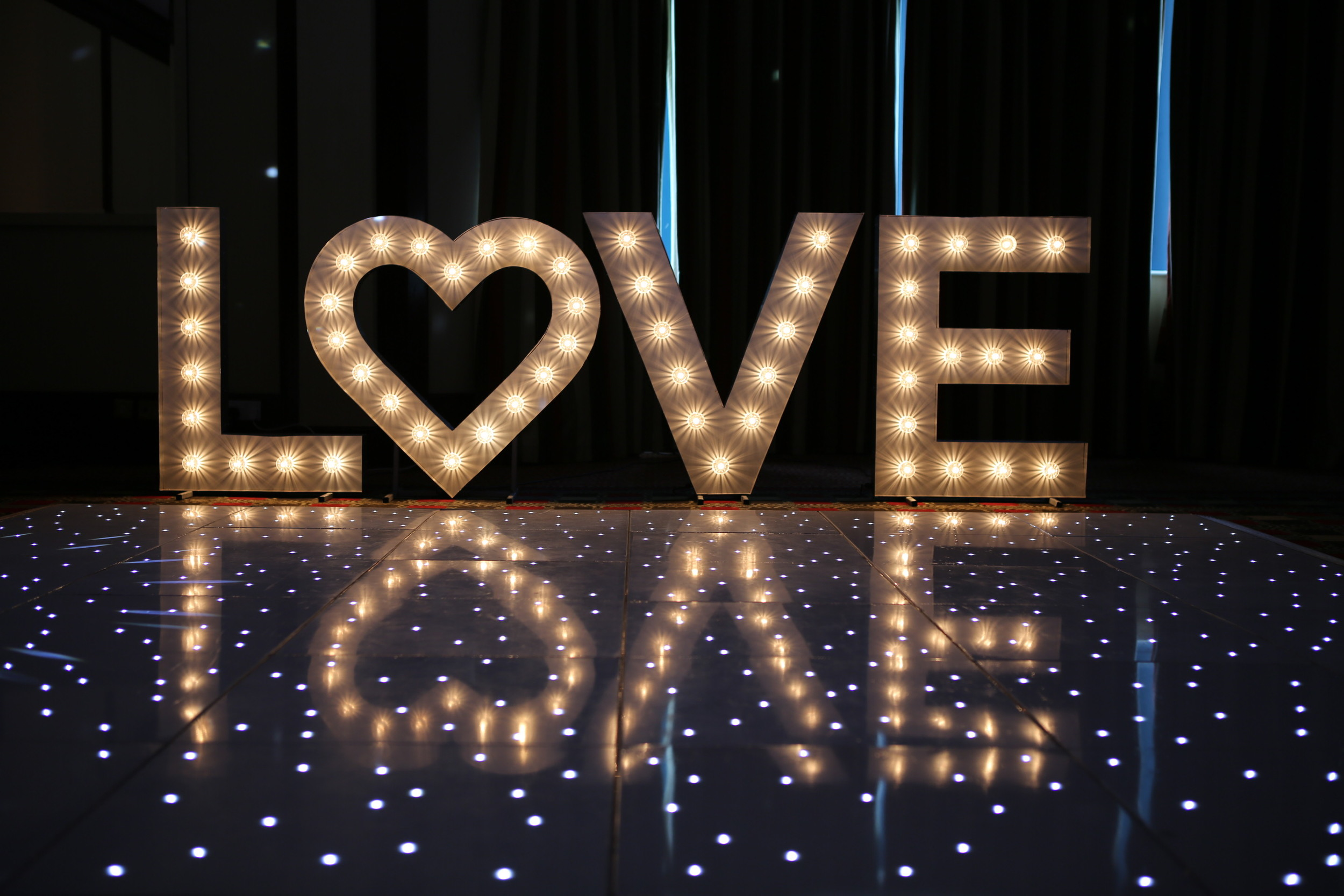 our vintage giant LOVE lettering - this look awesome and we can dim the lights for a lovely mood. Simply beautiful lighting solutions form BlueMark Entertainment your hertfordshire based wedding DJ