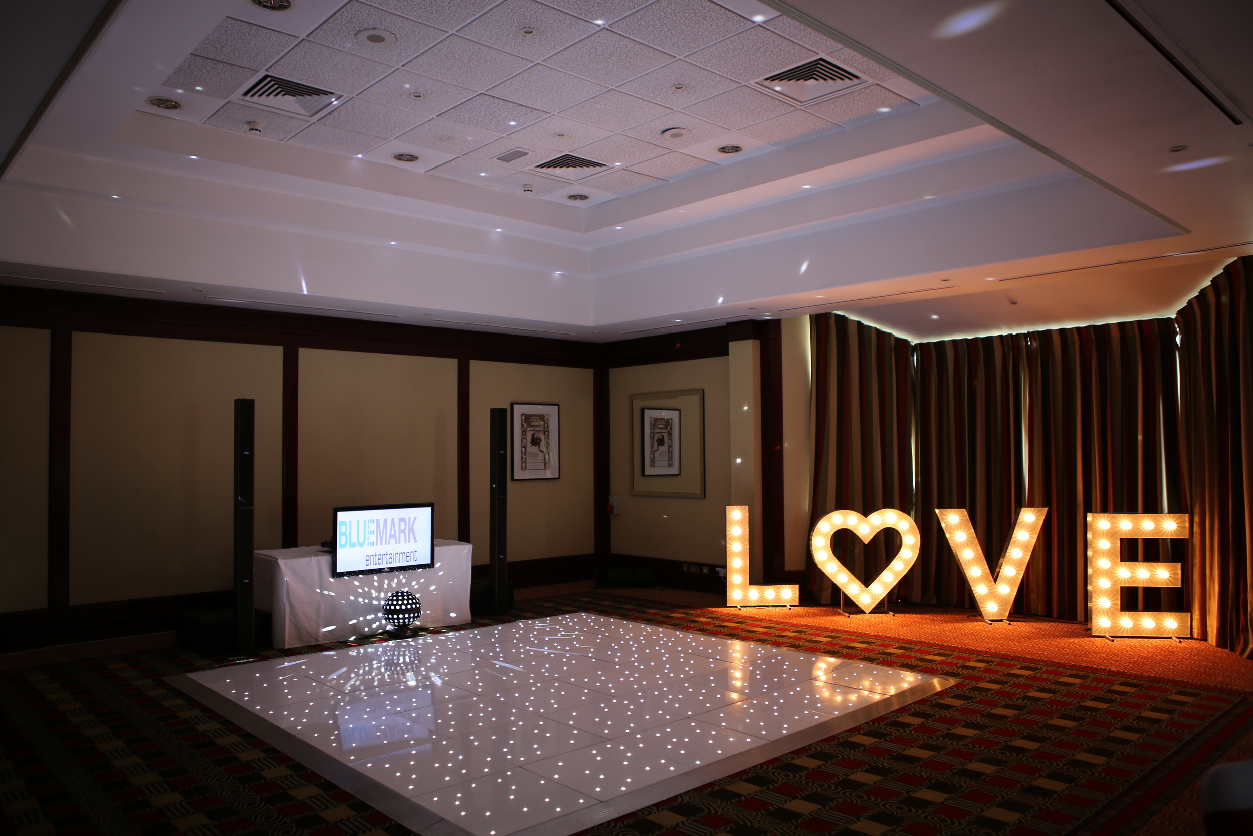 Awesome hertsweddindj with video scree, starlit LED dance floor and giant LOVE lettering at The Holiday Inn in Borehamwood. A magical wedding for lovely people