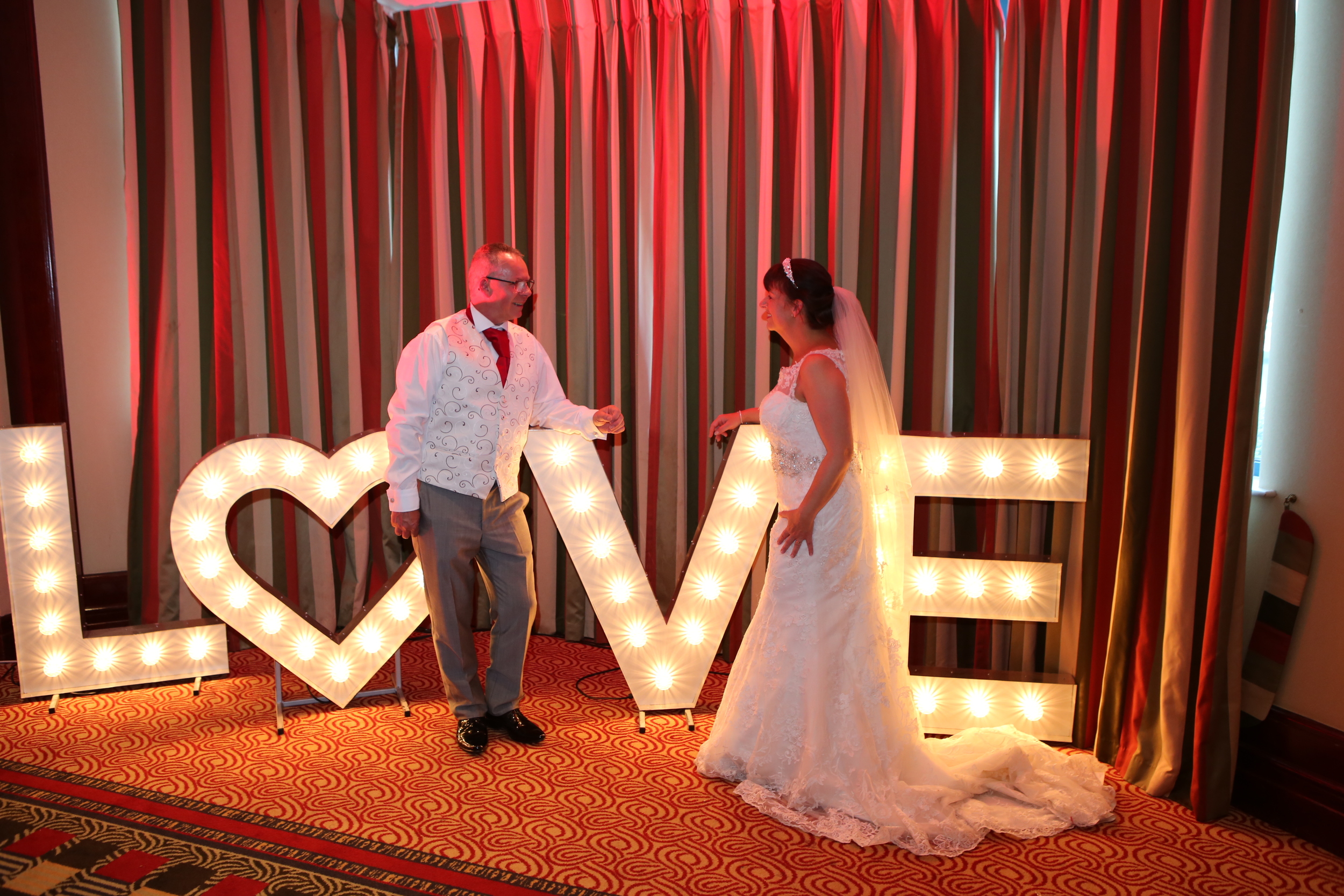 Bride and Groom at Holiday Inn in Borehamwood with our uplighting, starlit led dance floor.