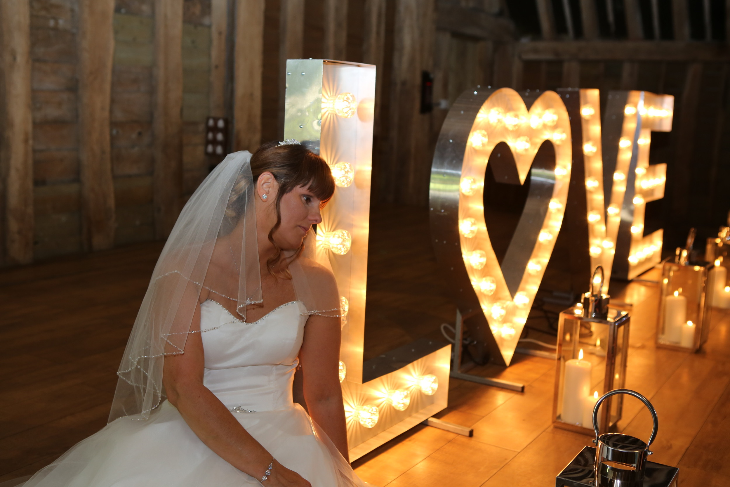 Bride with our giant LOVE lettering at The Priory Barn in Little Wymondley, Hertfordshire.