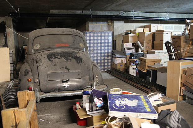 Abandoned cars in the basement  image courtesy of  Cycling Industry News