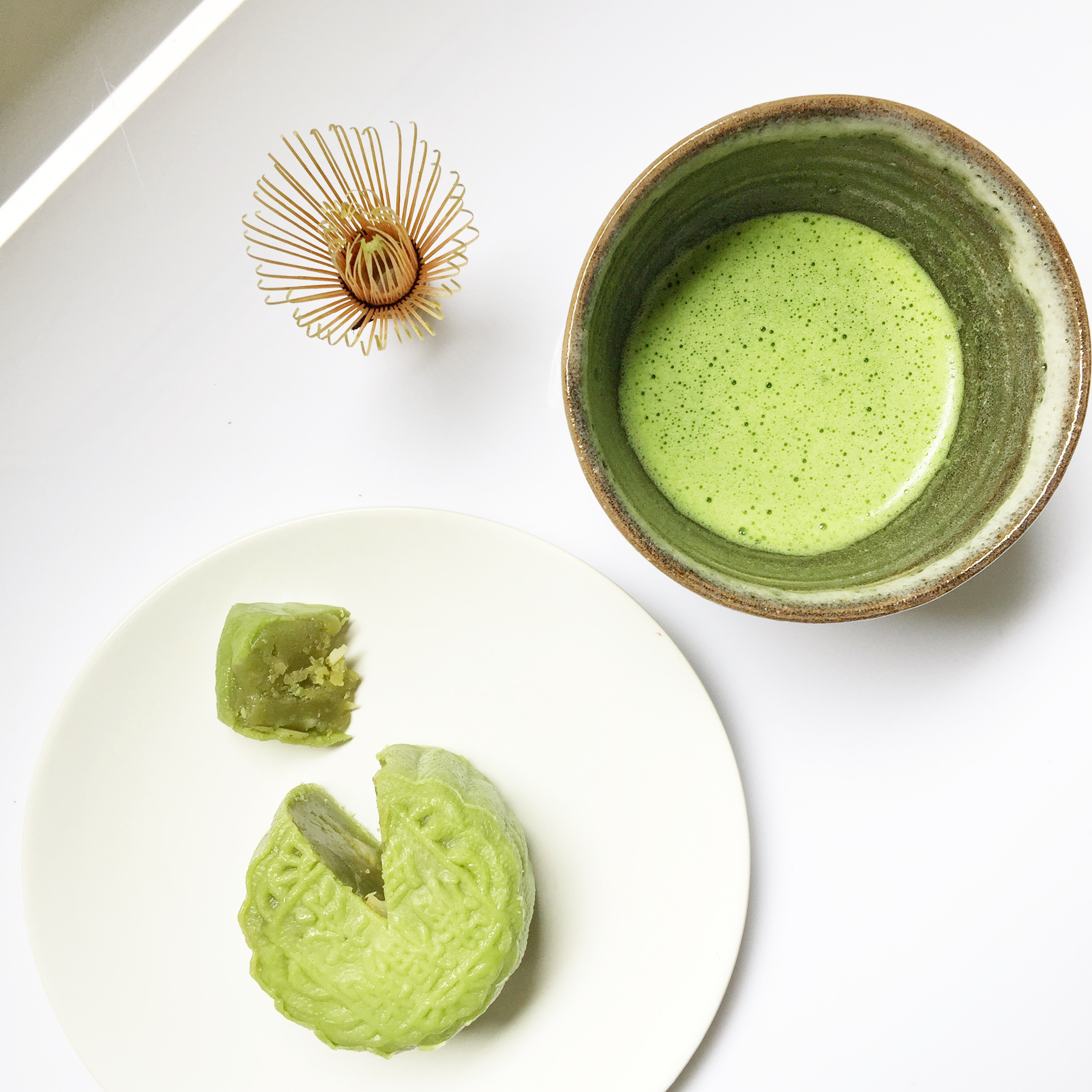 Janice Hunter's tea bowl used to whisk matcha, served alongside matcha mooncakes from Intercontinental Singapore.