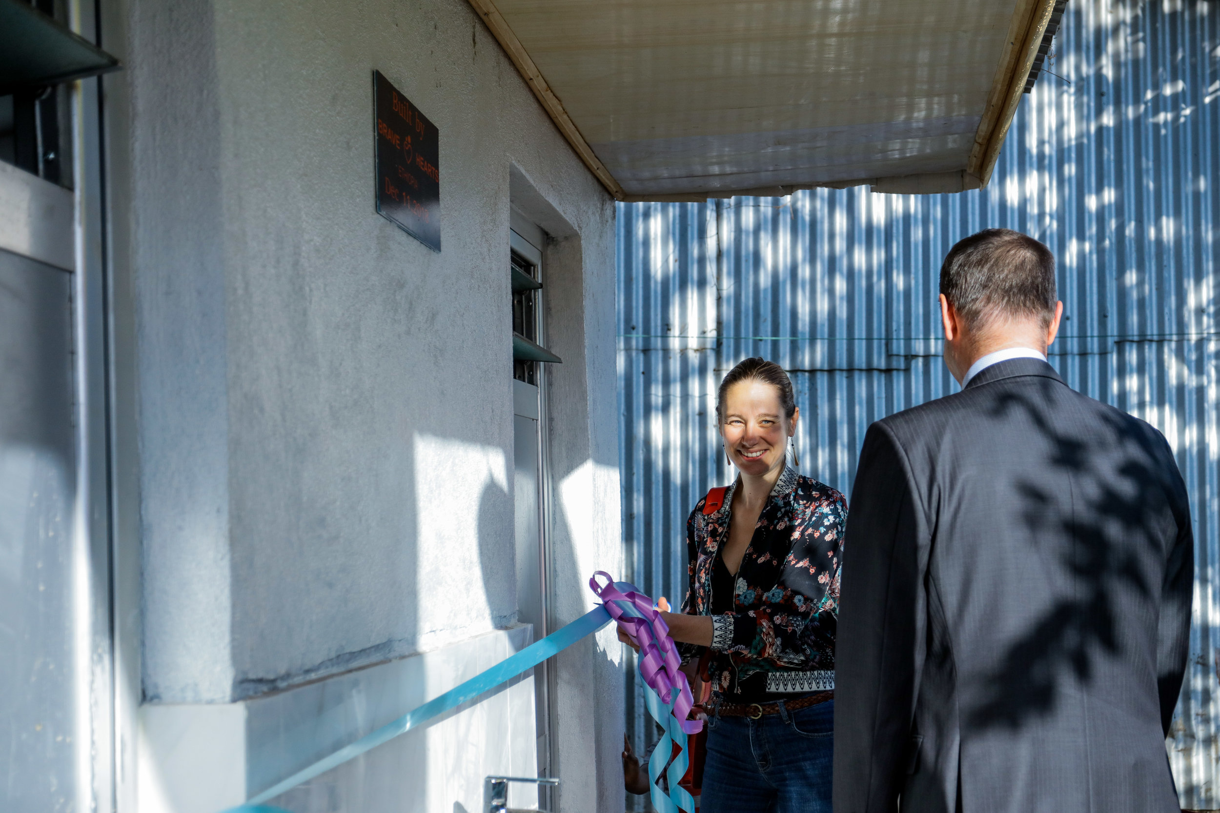 Australian Ambassador Mark Sawers and His wife Anais Maro officially opening the BHE community toilet and shower  Photo Credit; Mekbib Tadesse