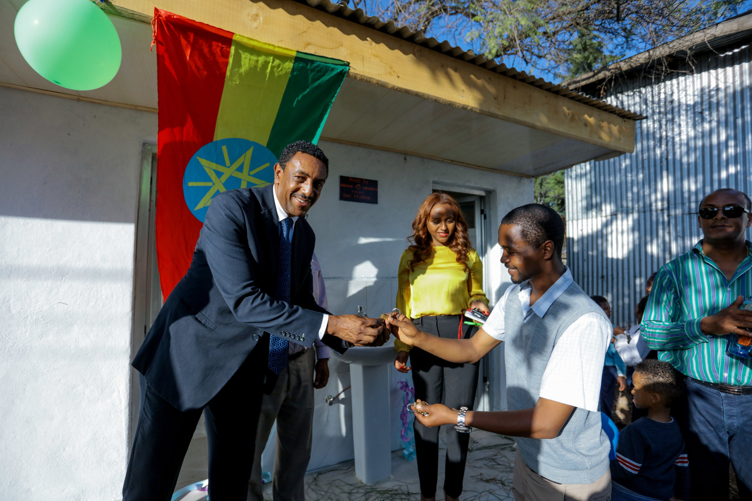 Ethiopian National team coach and BHE Board Of Director, Abrham Meberatu handing over the keys to the facility
