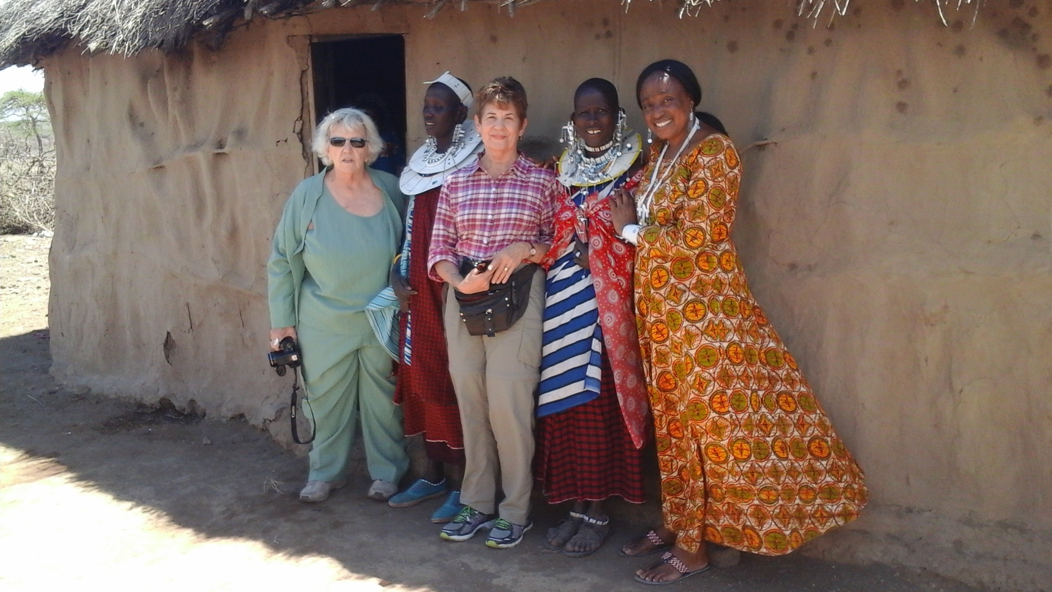 Our clients Judy and Kathy with our friend Margaret at the Maasai village.