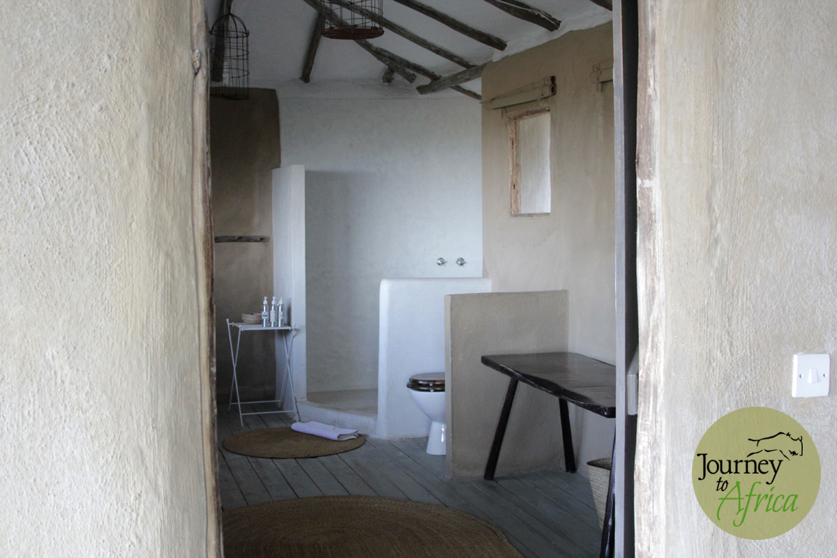 There is a door for privacy to this large spacious bathroom.