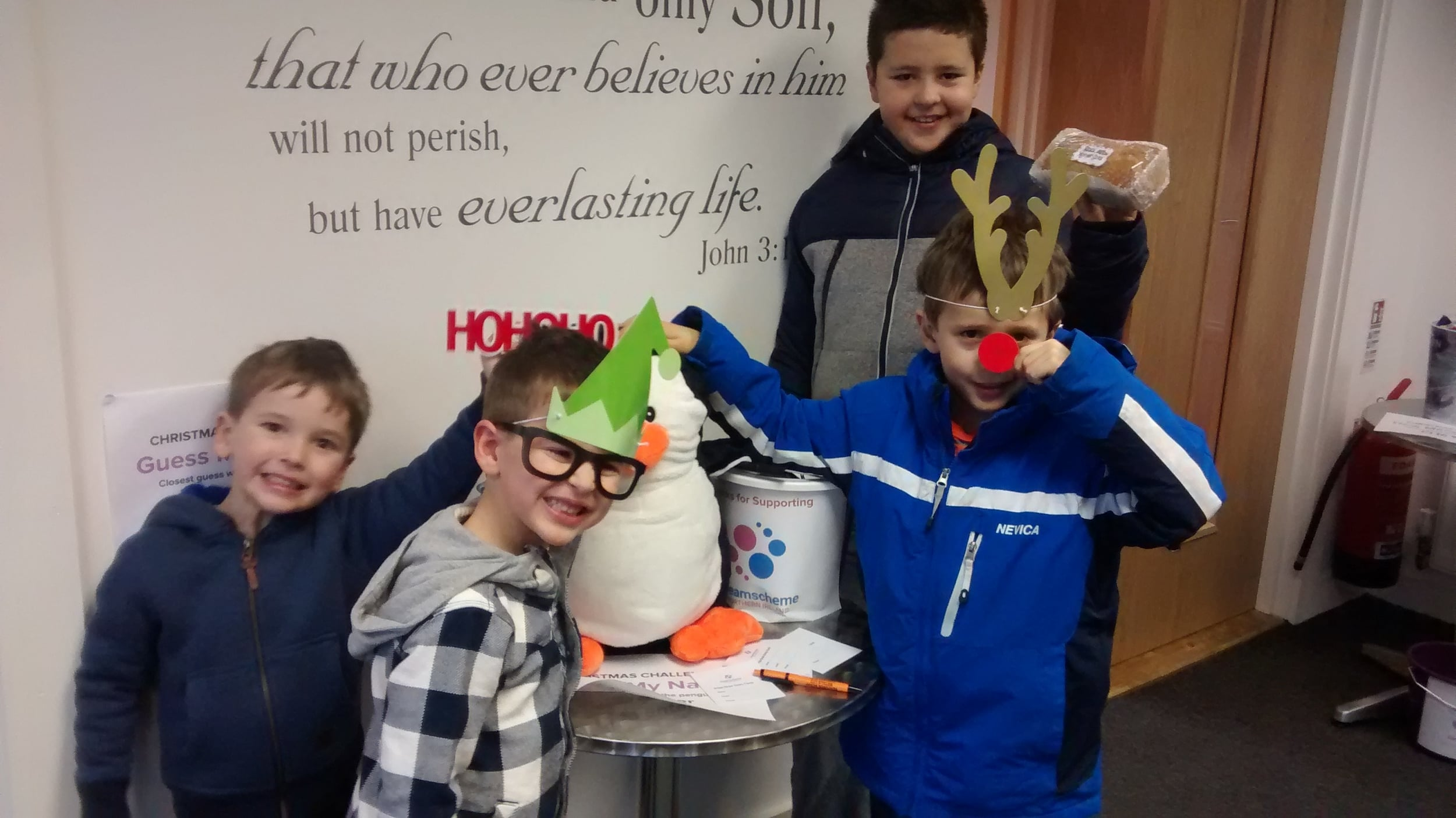 Some young visitors with Frosty the Penguin!