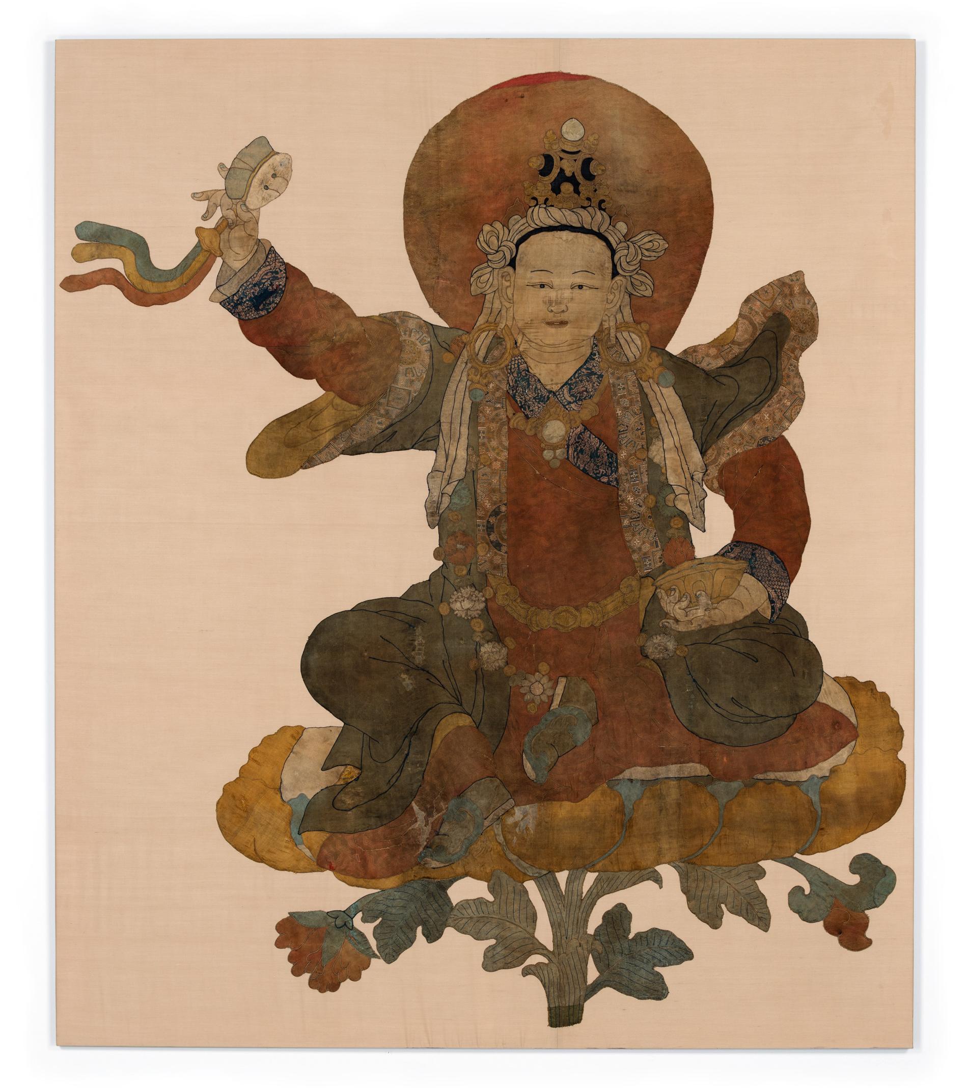 Padmasambhava as Loden Choksé, Tibet, 17th century, silk appliqué, 84 1/8 x 71 5/8 inches, image courtesy Rubin Museum of Art