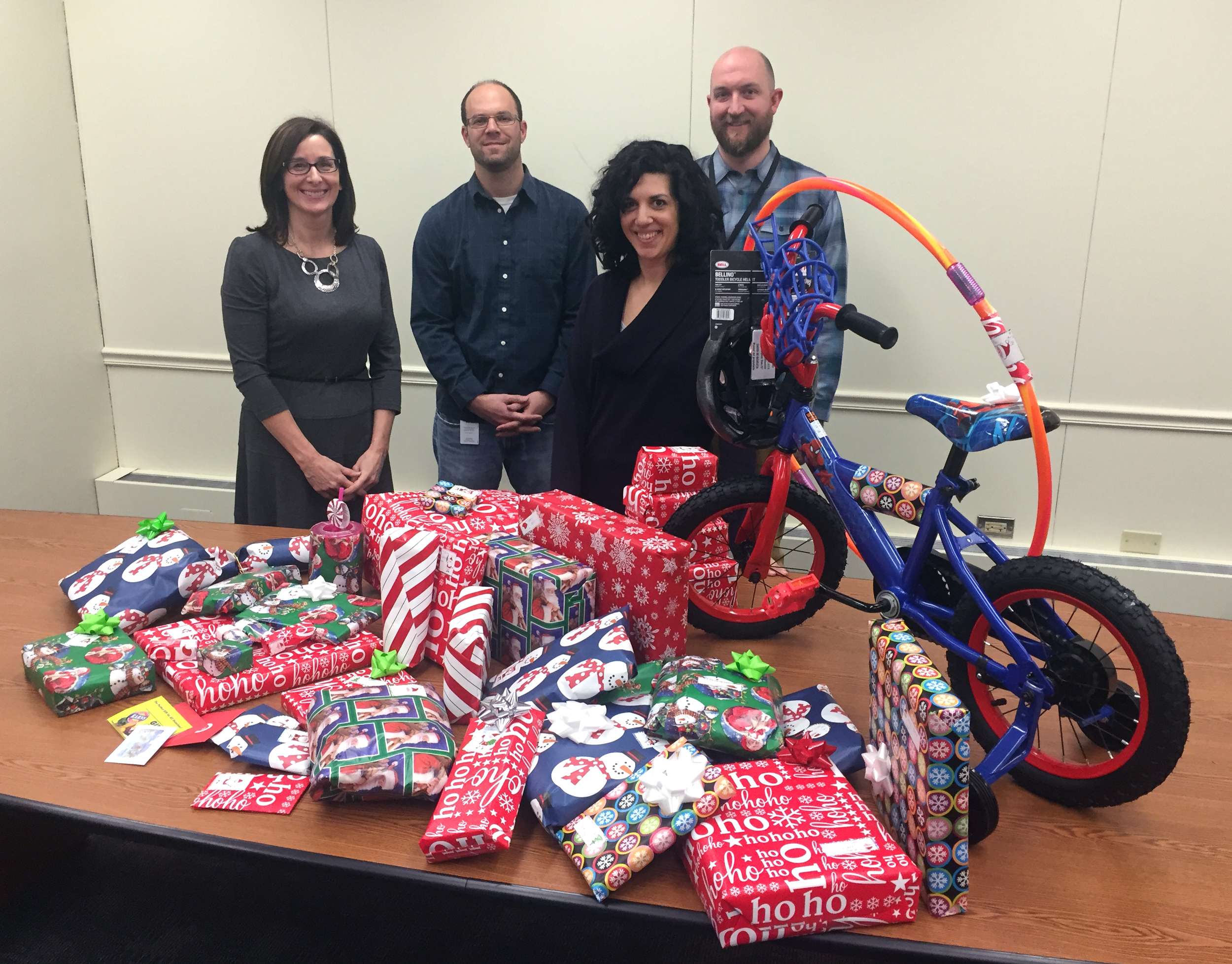 ^ GeoDecisions employees   Andrea Marsters, Bradley Pomerantz, Abigail Ketchum, and Christopher Bley wrapped gifts for the 2015 Pennsylvania Holiday Wish program.