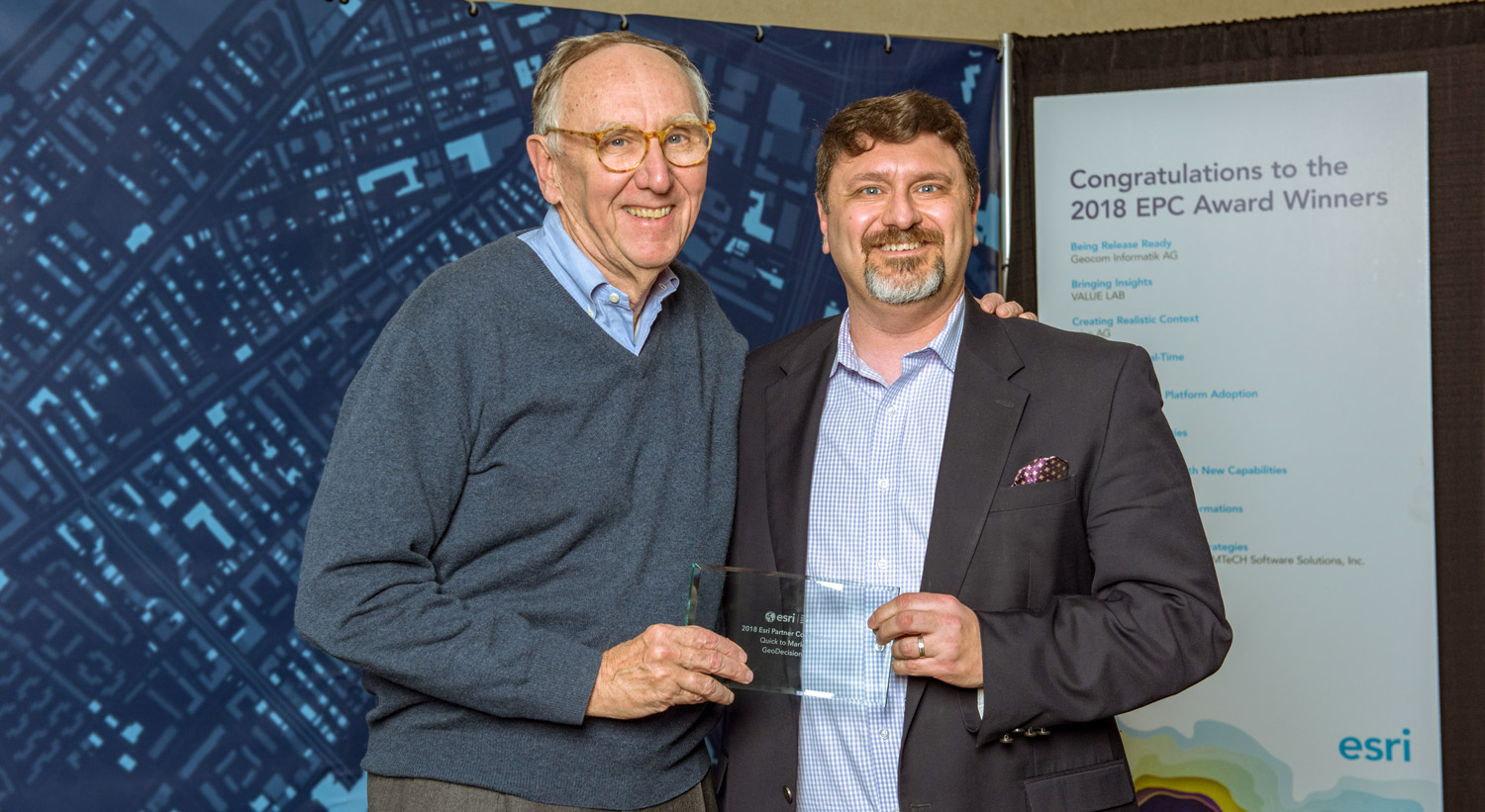 Brendan Wesdock, GeoDecisions CEO receiving the Esri Quick to Market Award from Esri's Founder and President Jack Dangermond.