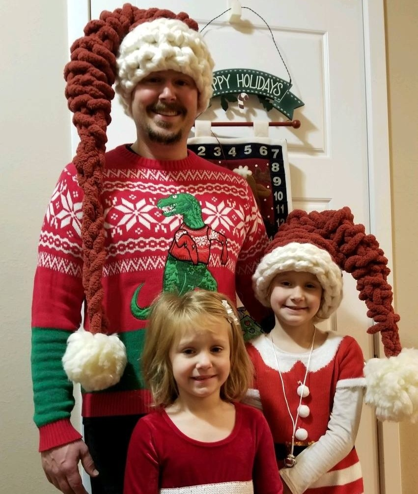 Bret Huber and his girls all dressed up!
