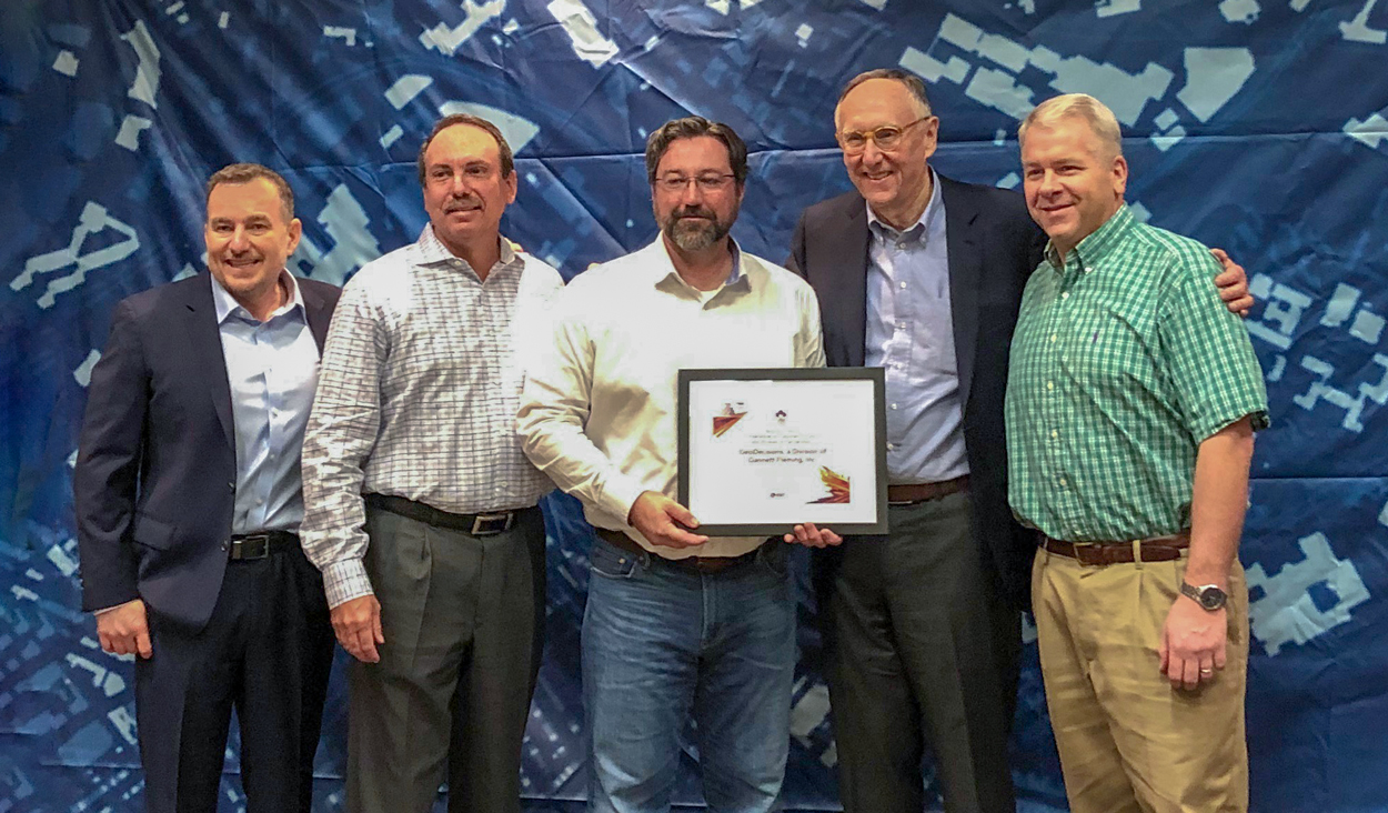 Esri presents GeoDecisions with Cornerstone Award at Esri Partner Conference in Palm Springs, CA, on Tuesday, March 4, 2019. Left to Right: Jeff Peters, director, Global Business Development, Esri; Greg Ulp, director, GeoDecisions; Brian Smith, vice president, GeoDecisions; Jack Dangermond, president, Esri; and Trent Park, senior vice president, GeoDecisions.