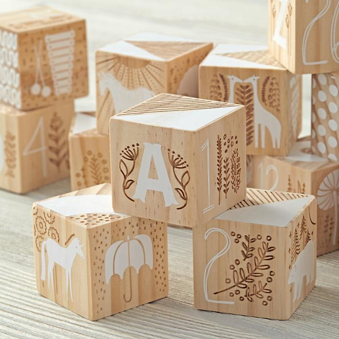 A close-up showing the combination of silk-screening and wood etching that makes these blocks feel like instant heirlooms.