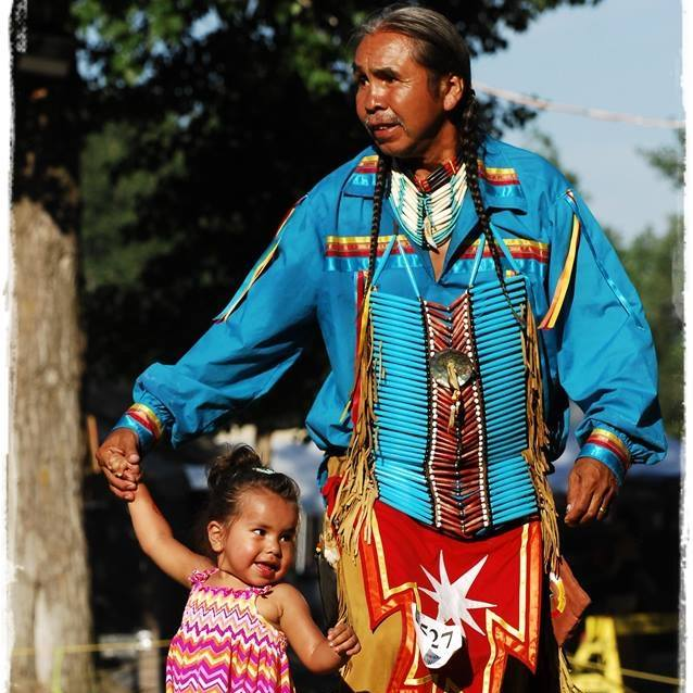 Delbert Sampson, Residential School Survivor, at a Pow Wow with his granddaughter