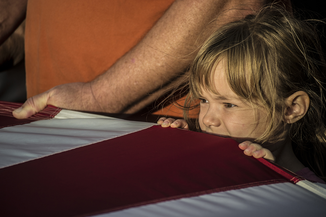 Sarah Kowakzyk, 6, from Indiana, helps to hold a large memorial American flag unfolded by visitors in a ceremony at the Flight 93 Memorial in Shanksville, PA on Sept. 10, 2014. The flag, honoring the victims of Flight 93, is unfolded during a service held every year on September 10 before a candlelight march and vigil.