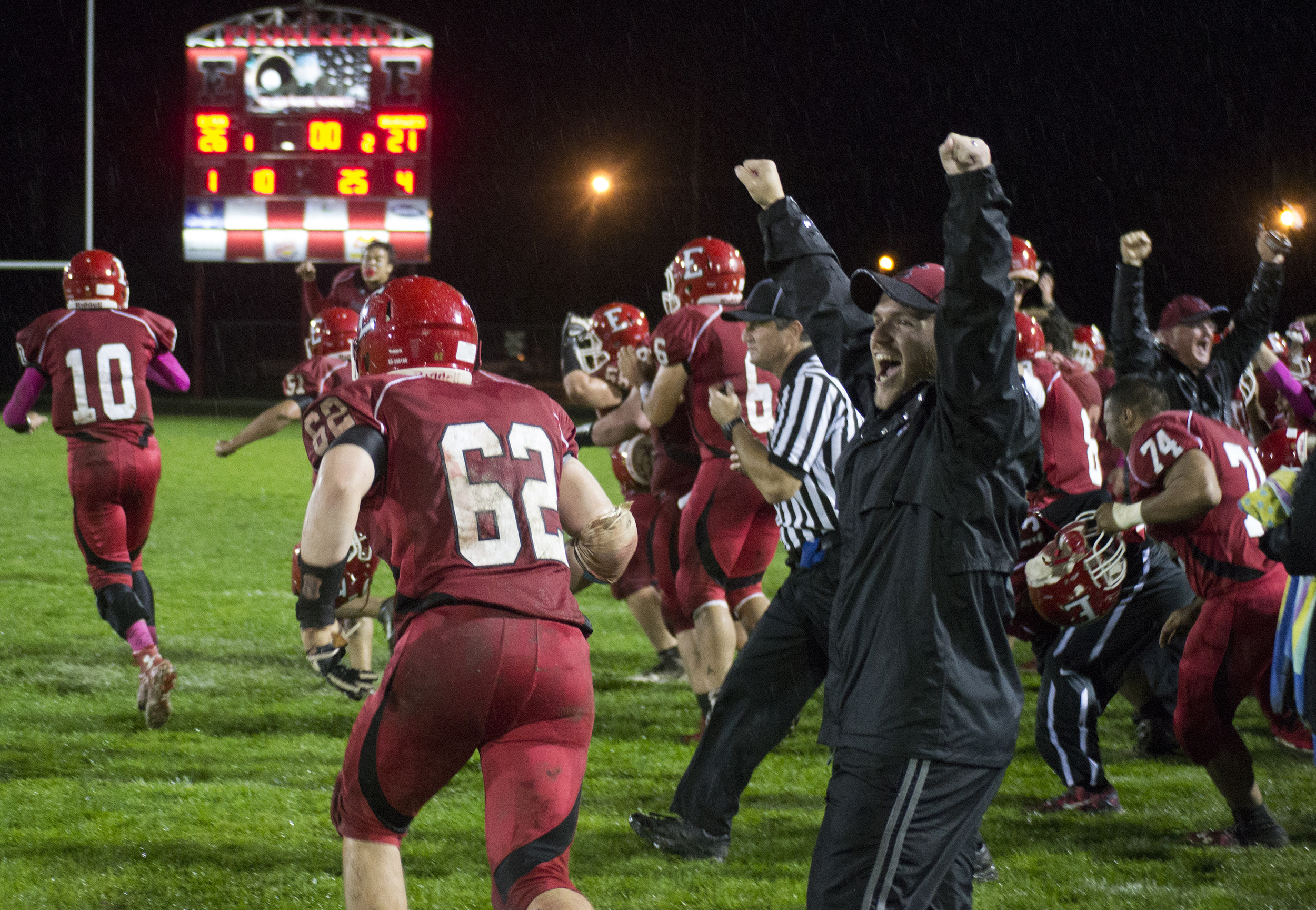 The Elyria High School football team rush onto field after a last second touchdown scored by Junior wide receiver Mikah Price won them their homecoming against Brunswick High School on Oct. 3, 2014.