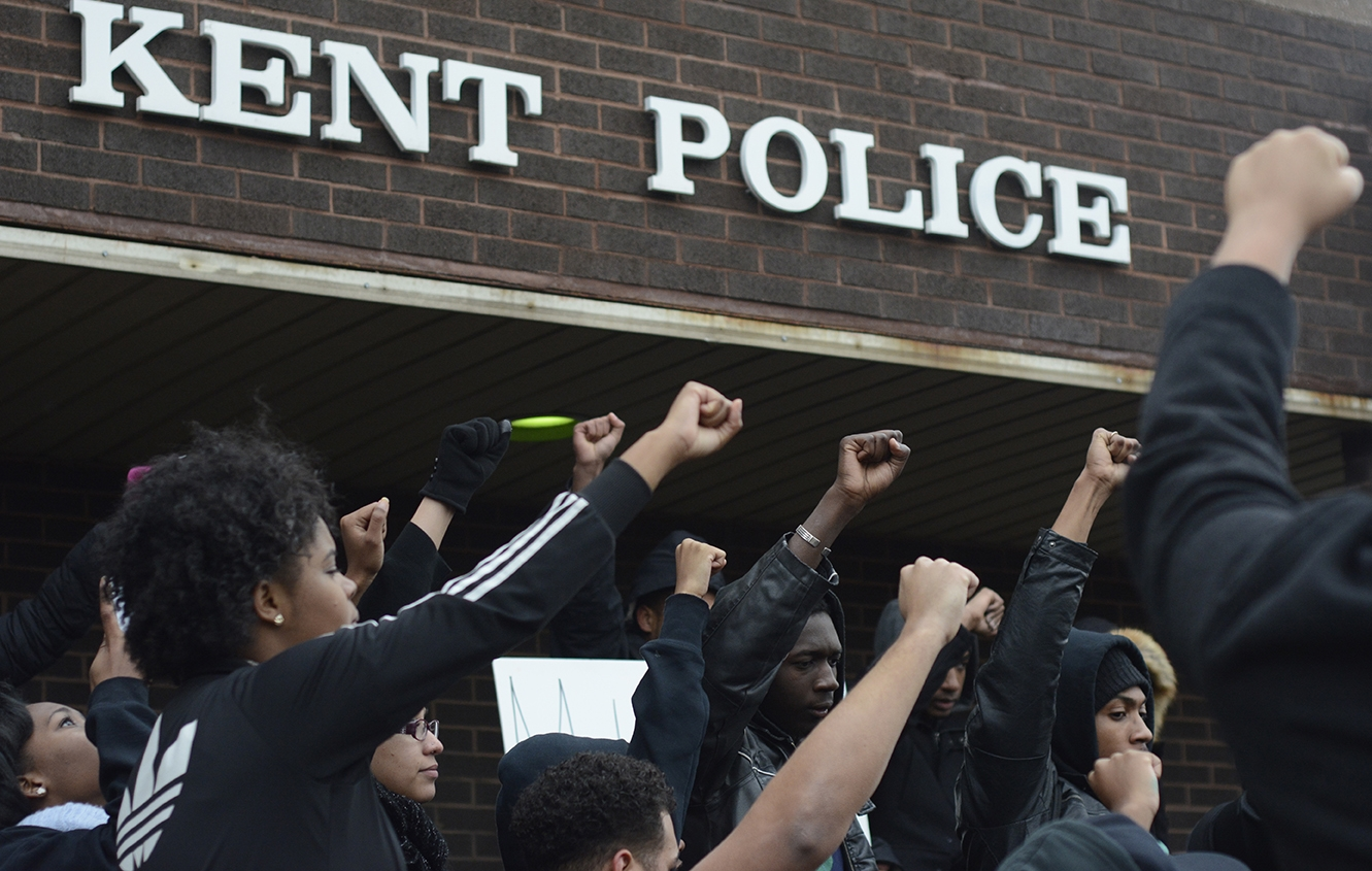 Student members of Black United Students protest outside of the Kent police department on November 25, 2014. The organization lead the march across campus to the Police Station in response to the announcement of no indictment for officer Darren Wilson for the killing of Michael Brown in Ferguson, MO.  Original story available at    kentwired.com