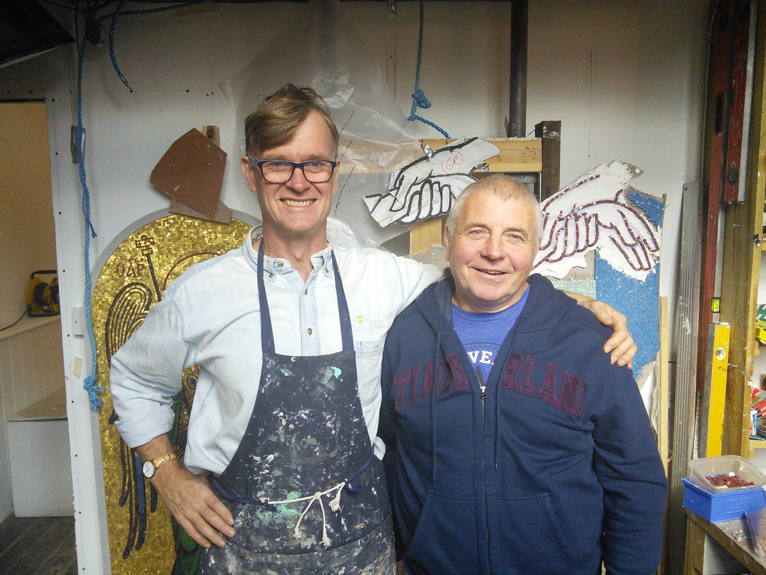 Aidan Hart (on left side of picture) in his workshop