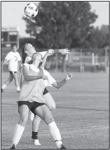 Cara Zwilling, Melissa Carey in a scrimmage.