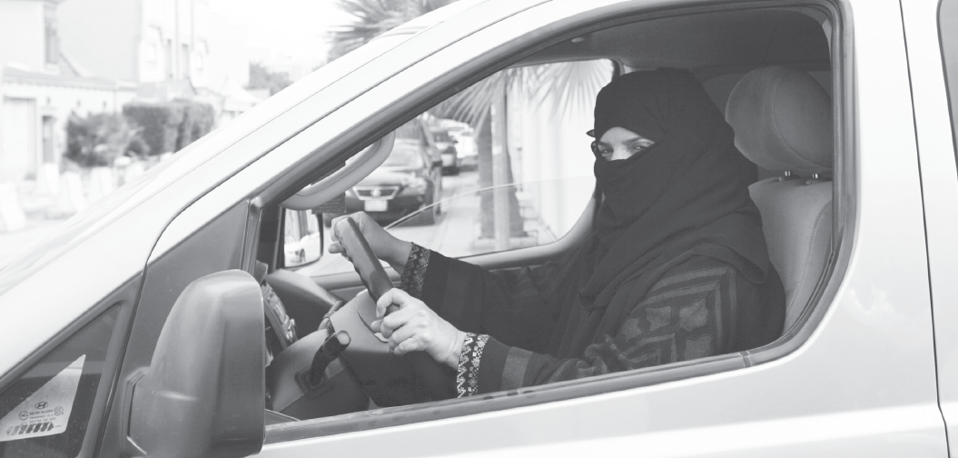 A woman drives a car in Riyadh, Saudi Arabia, as part of a campaign by locals to defy Saudi Arabia's ban on women driving.