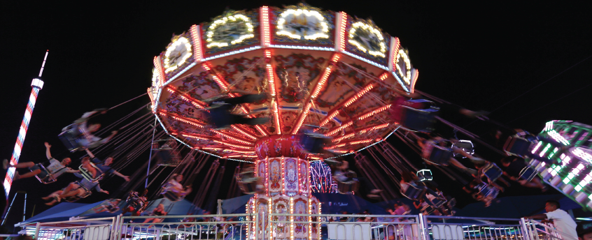 The swing ride on the Midway illuminates the night at The Texas State Fair, which continues through Oct. 22 at Dallas Fair Park.