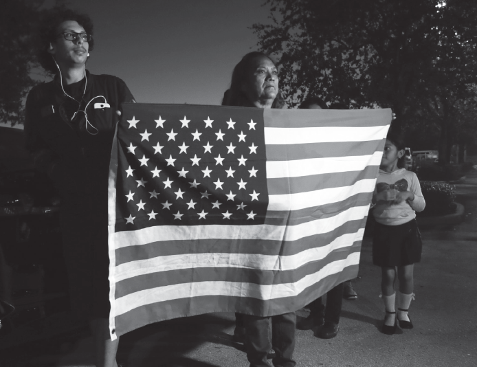 Antonia Catalon holds an American flag during a rally in support of Dreamers outside of the office of Sen. Marco Rubio, R-Fla., Nov. 7, in Doral, Fla.