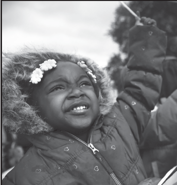 Eternity Wright, 3, waves an American flag during the Martin Luther King Jr. parade in Dallas on Jan. 15.