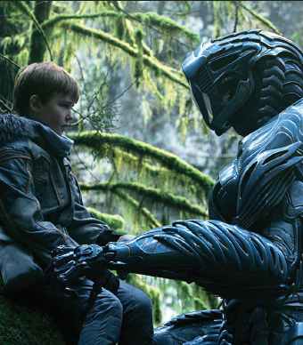 """Maxwell Jenkins, left, and Brian Steele as the robot in """"Lost in Space."""""""