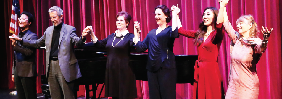 Pianist In Seub Jung (left) joins vocal professors on stage after their performance on Feb. 6.