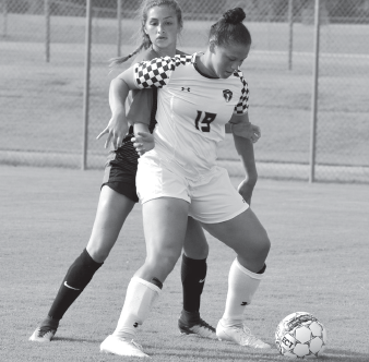 Asia Revely shields the ball away from the Hill College player on Aug. 22. Richland won 3-0.