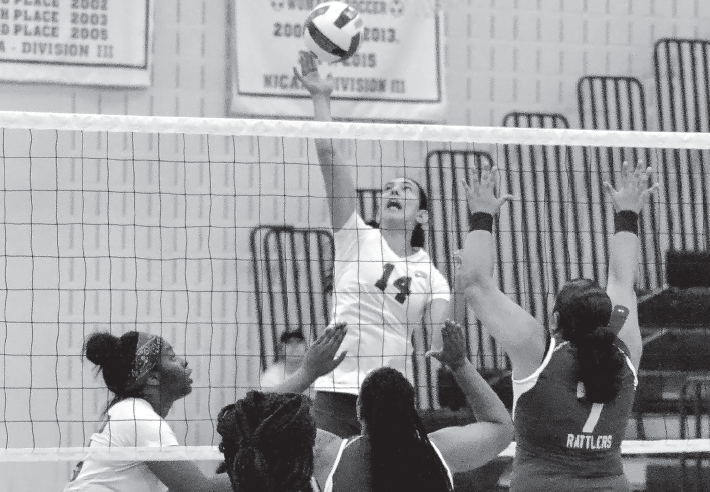 Lorena Perez climbs high to smash the ball for the victory against S.W.C.I.D on Aug. 31.