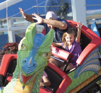 Fairgoers enjoy a ride during opening day of the State Fair of Texas on Sept. 28.